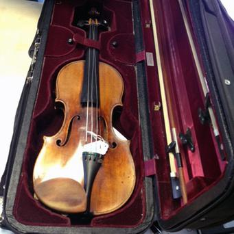 Police have recovered a 1696 Antonio Stradivarius violin worth more than one million pounds (British Transport Police/PA)