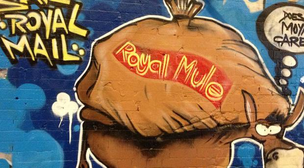 A huge mural bearing the slogan Save Royal Mail has been painted in London