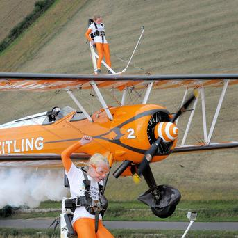 Nine-year-old cousins Rose Powell (front) and Flame Brewer flying over Gloucestershire for the Duchenne Children's Trust charity, becoming the world's youngest formation wingwalkers.