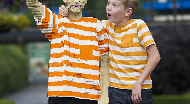 Jack Covill-Lowndes, who has raised thousands of pounds for charity since he lost his mother to cancer, with his Lego counterpart