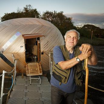 An artist is to spend a year living in a floating wooden egg for a project designed to connect people with the environment