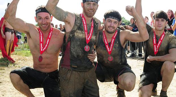 Lance Bombardier James Simpson, a double amputee, celebrates with friends (left to right) Tom Storey, James Simpson, Phil Midwinter and Jonny Sedman as they finish the Spartan Race in Ripon