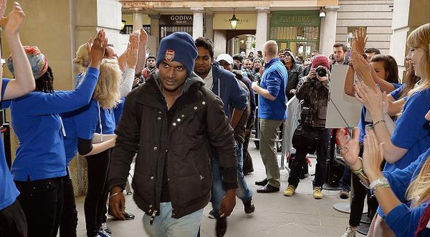 Customers were cheered on by store workers as they entered the Apple store in Covent Garden, central London, to buy the new iPhones