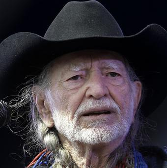 Willie Nelson performing at the New Orleans Jazz and Heritage Festival.