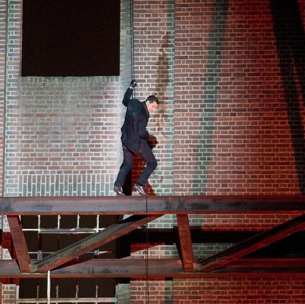 Bear Grylls abseils down a side of Battersea Power Station. Special effects at the event sparked erroneous fears that a fire had started.