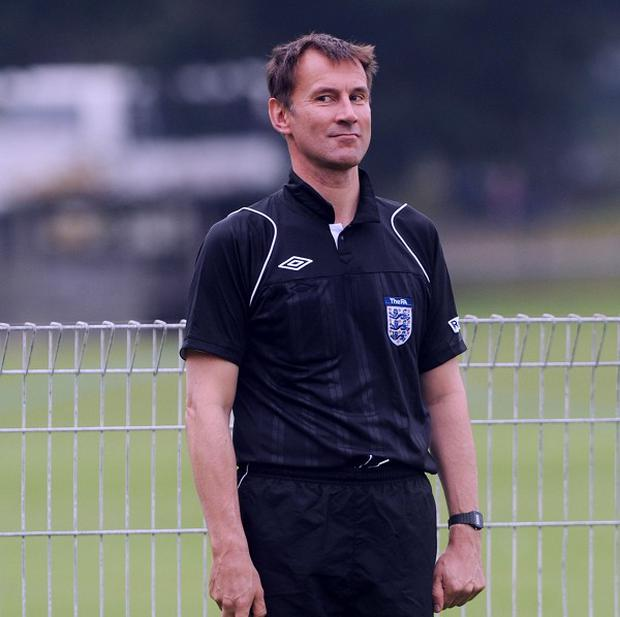 Health Secretary Jeremy Hunt acted as a linesman during a football match between Conservative MPs and the press