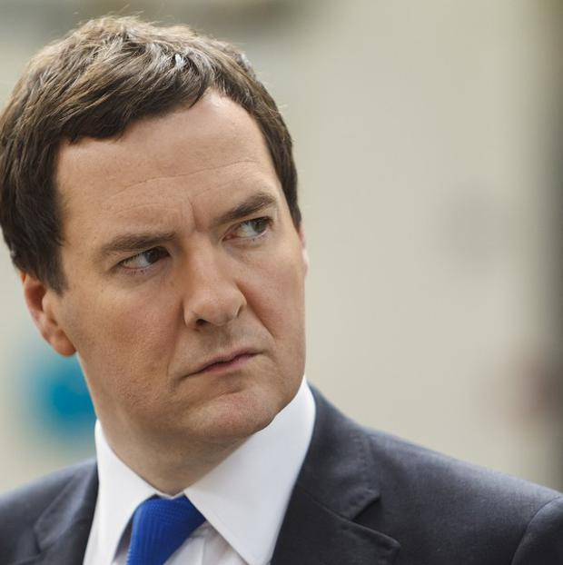 Chancellor George Osborne says his new haircut is to cover up the fact he is going bald