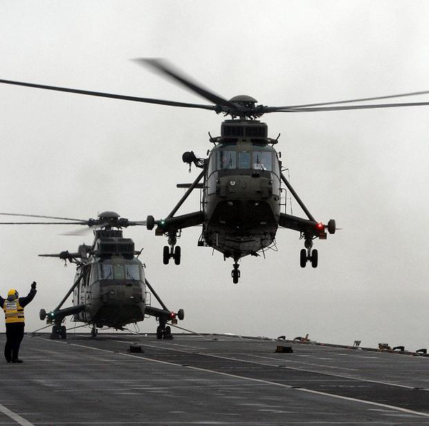 A baby was born on board a Royal Navy Sea King helicopter.