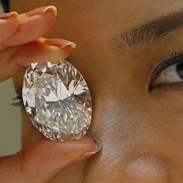 A 118.28-carat white diamond sold for £19 million at a Hong Kong auction (AP/Vincent Yu)