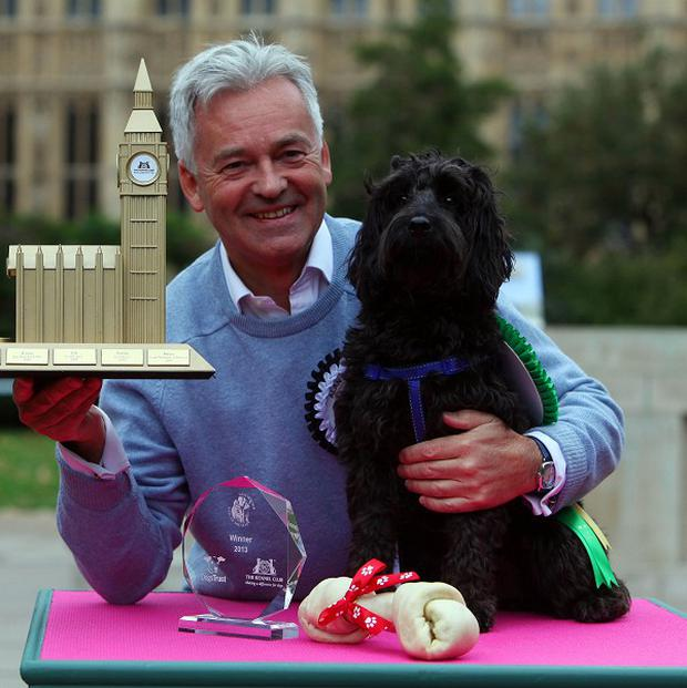 MP Alan Duncan with his cockapoo Noodle, who was named winner of the Westminster Dog of the Year competition at Victoria Tower Gardens in London, organised by the Dogs Trust and The Kennel Club