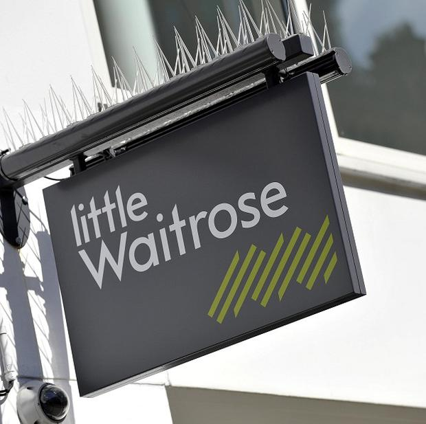 Supermarket group Waitrose has continued to outperform the under-pressure grocery sector after figures showed a lift in Christmas sales