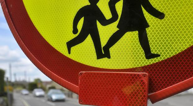 A lollipop man who high-fived school children said he was threatened with suspension for the friendly gesture