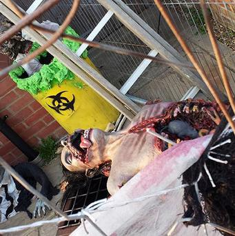 James Creighton's Halloween display of disembowelled corpses outside his home