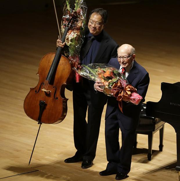 Cellist Yo-Yo Ma and Holocaust survivor George Horner after performing at Boston's Symphony Hall.