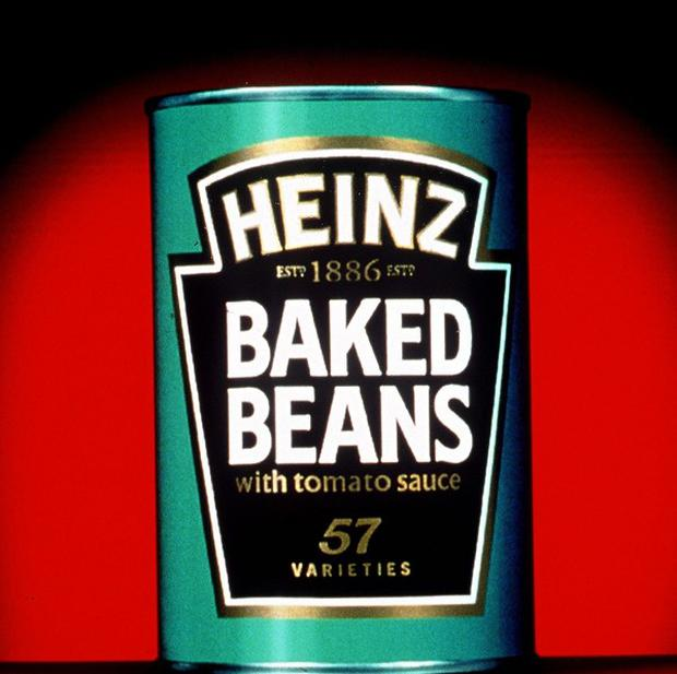 Thousands of tins of baked beans have been stolen from a lorry while the driver was asleep in his cab