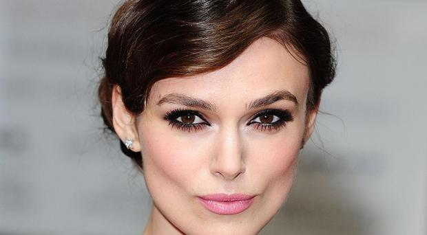 Women with attractive faces, such as Keira Knightley, are more likely to win the trust of children, psychologists said.