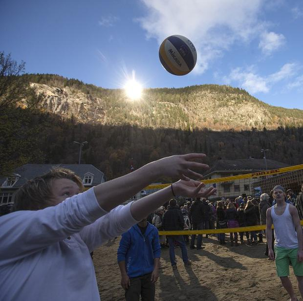 A group of youths play games after the official opening of giant sun mirrors in the town of Rjukan, Norway |(AP/NTB Scanpix)