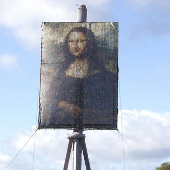 A 14 metre high easel displaying a five metre by seven metre canvas of the Mona Lisa