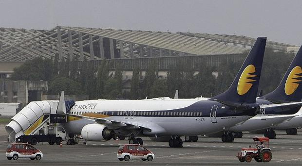 Twenty-four gold bars were found hidden in the toilet of a Jet Airways plane