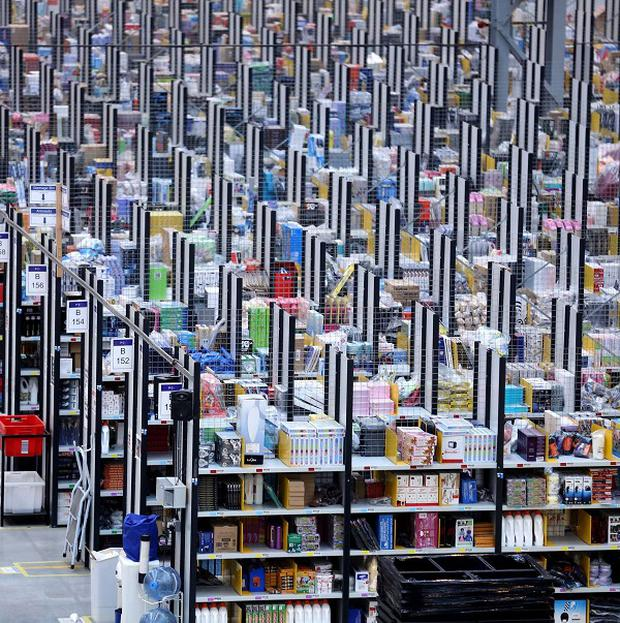 A packed Amazon warehouse - the firm is looking at using unmanned flying drones to deliver goods in the US