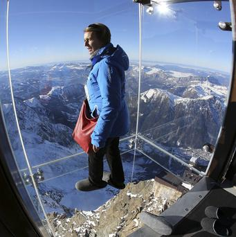 A French company has suspended a glass viewing cage thousands of feet up in the Alps (AP)