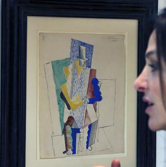 An American has won Picasso's 1914 cubist drawing Man With Opera Hat for £83 in a French online Christmas raffle. (AP)