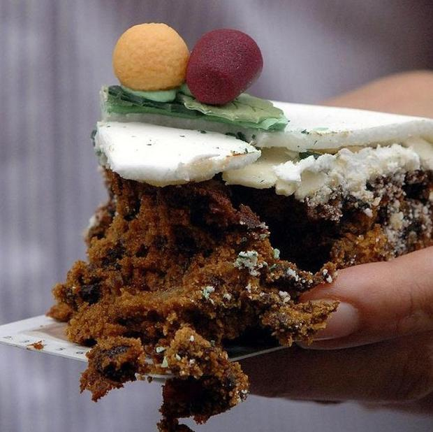 Ten chefs rolled their sleeves up to bake a 1,534lb Christmas cake