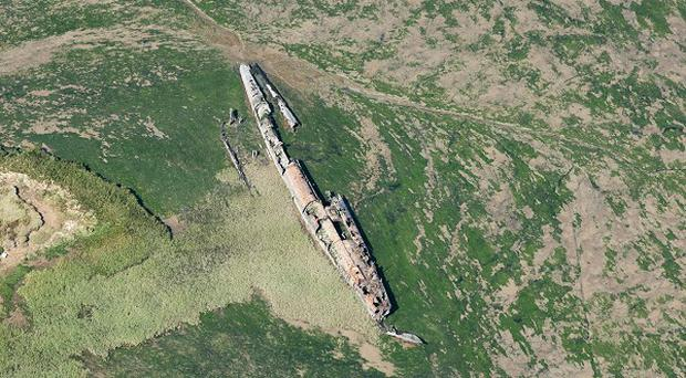 A German First World War U-boat, believed to be UB 122, lies exposed on mudflats on the River Medway in Hoo, Kent. (English Heritage)