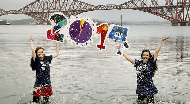 Erin Whyte (left) and Bethany Lawrie promote the Loony Dook in the freezing cold Firth of Forth