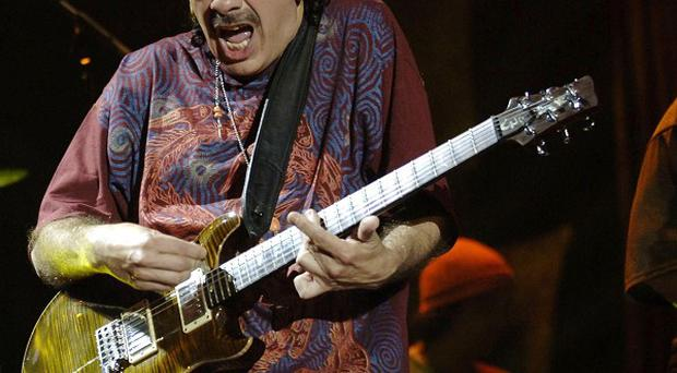 Carlos Santana has been reunited with a now-homeless bandmate.