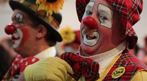 People in clown costumes have been scaring passers-by in a craze which the clowning community fears will tarnish its good name