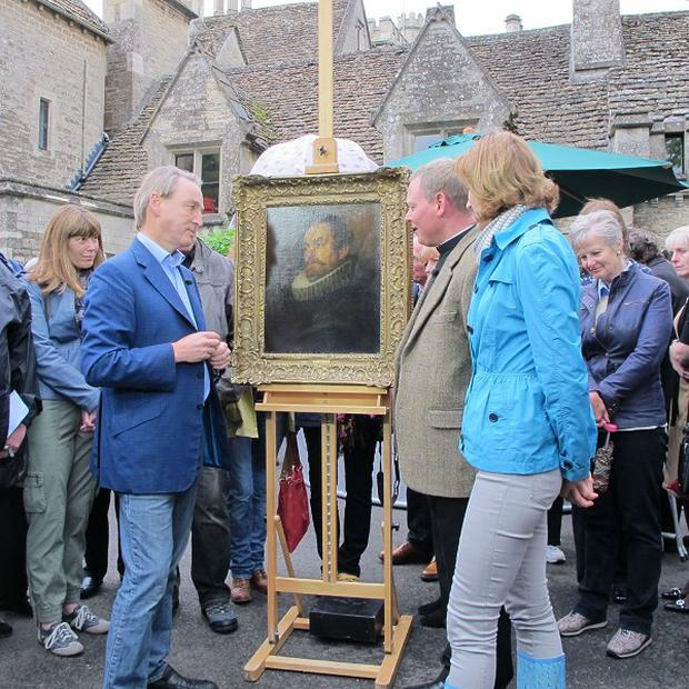 Father Jamie MacLeod with the van Dyck portrait, bought for £400, with Antiques Roadshow host Fiona Bruce and expert Philip Mould during the recording of the programme where it was revealed to be worth for £400,000.