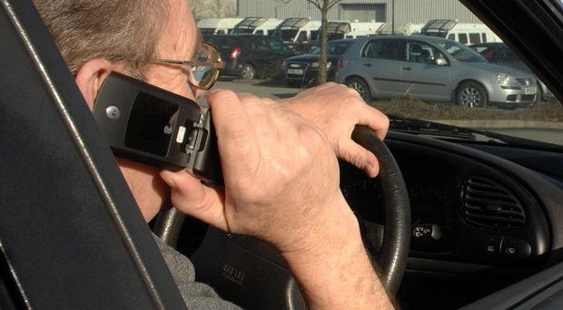 Even reaching for a mobile phone while driving can increase risk