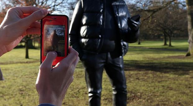 Eddie Sizer from Australia takes a picture of Network, a sculpture by Tom Price at a new exhibition at Yorkshire Sculpture Park in Wakefield, West Yorkshire
