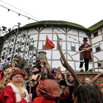 A group of Shakespearean performers on the steps of the Globe Theatre during the annual celebration of William Shakespeare's Twelfth Night on the South Bank