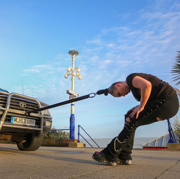 Anastasia IV uses her hair to pull a four-tonne vehicle along Eastbourne seafront