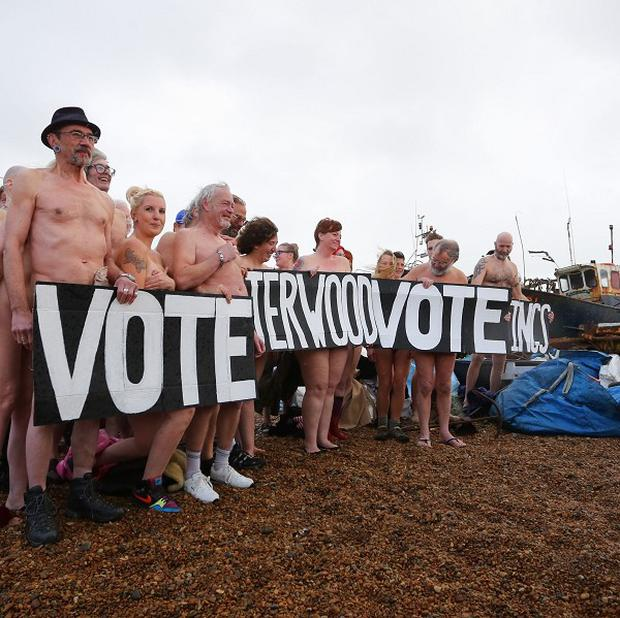 Residents of Hastings in East Sussex bare all in a naked flash mob on the beach, as the Jerwood Gallery in the town competes to win a photographic portrait session with photographer Spencer Tunick