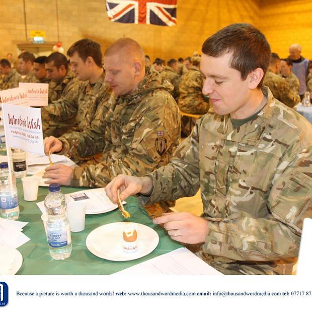 Soldiers at Imjin Barracks, Gloucester during the Winston's Wish Great British Brekkie World Record Attempt for Most Soldiers Dipping Egg Soldiers simultaneously