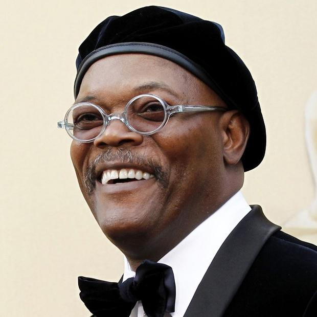 Samuel L Jackson has received an apology from a reporter who confused him with actor Laurence Fishburne in an interview (AP)