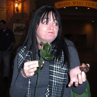 An unexpected wave of saltiness hits Melissa Ehrke as she tries chocolate-covered bacon strips shaped like a rose (AP)