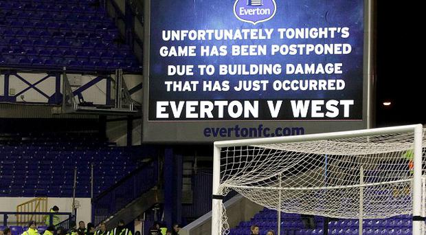 A giant video screen at Goodison Park informs fans that the game has been postponed