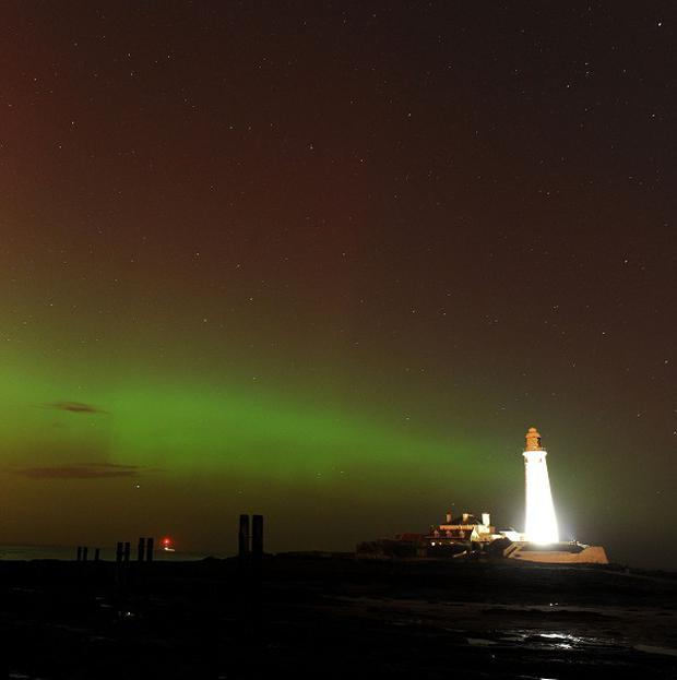 The Aurora Borealis, or the Northern Lights as they are commonly known, at St. Mary's Lighthouse and Visitor Centre, Whitley Bay, North Tyneside.