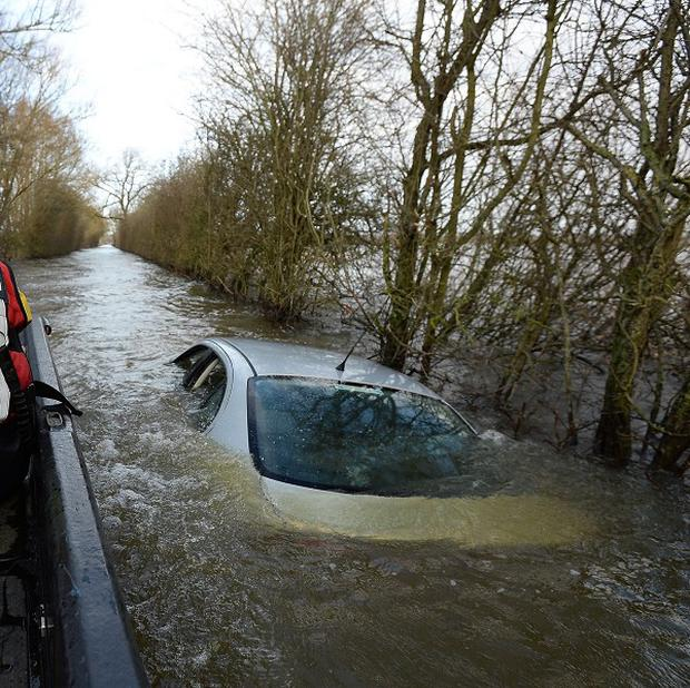 A car abandoned in floods on the Somerset Levels was put up for sale on eBay by owner Hubert Zajaczkowski, 21