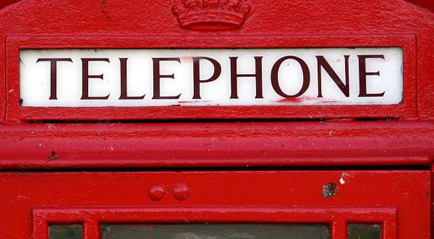A woman had to dial 999 after becoming trapped in a phone kiosk