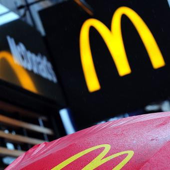Police were called after a man wearing a balaclava and brandishing a hand gun burst into a McDonald's in Peterborough.