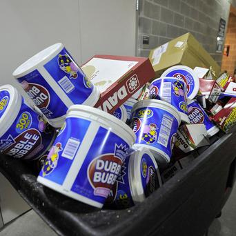 A rubbish bin full of bubble gum, at Yankee Stadium, in New York - US gum sales tumbled in the past four years (AP)