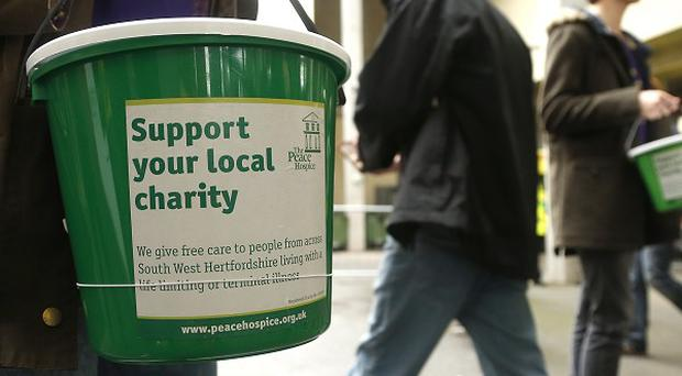 People with higher bonuses are less inclined to give to charity, research suggests.