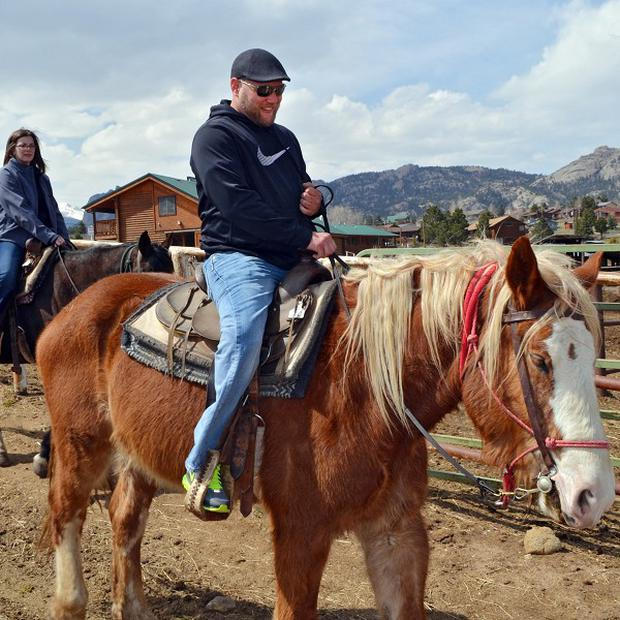 Increasingly bigger horses are being used by wranglers to cope with the size of weightier riders looking for a taste of life in the Old West (AP)
