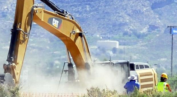 Crews begin digging at the old Alamogordo landfill for copies of the Atari game ET The Extraterrestrial purportedly buried there in the 1980s (AP/Alamogordo Daily News)