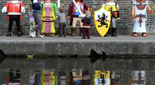 Giant Playmobil characters come to life to celebrate the launch of Playmobil's 40th anniversary, at the Pirate Castle, Camden Lock, London